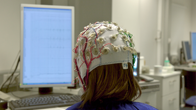 Person in Electroencephalography Cap