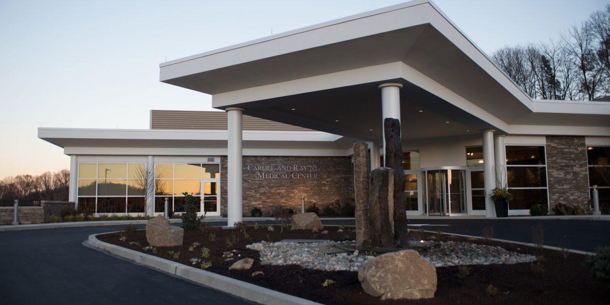 Neag medical center exterior sunset front closeup