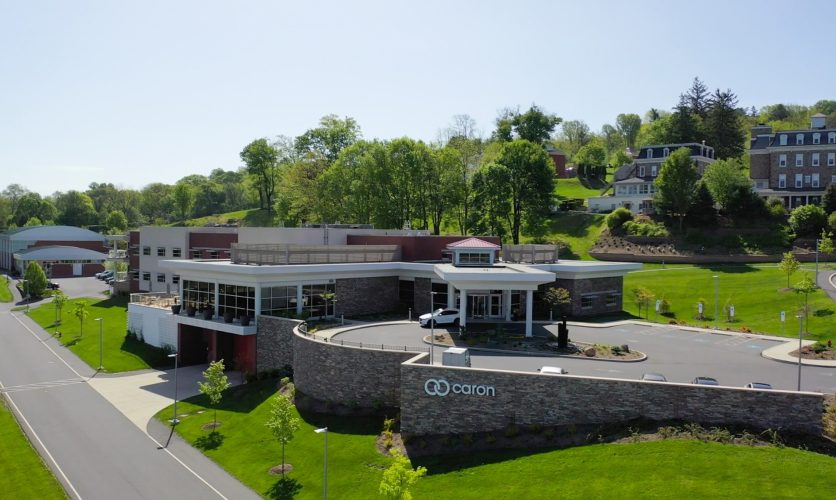 Front drone shot of the caron campus in Pennsylvania.