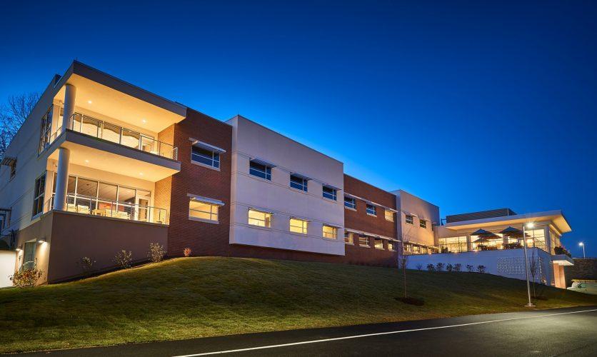 Caron Pennyslvania Campus Neag Medical Center exterior building at night.