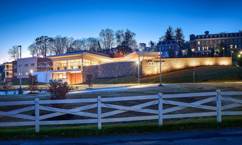 Caron Pennsylvania Campus Neag medical center exterior at twilight.