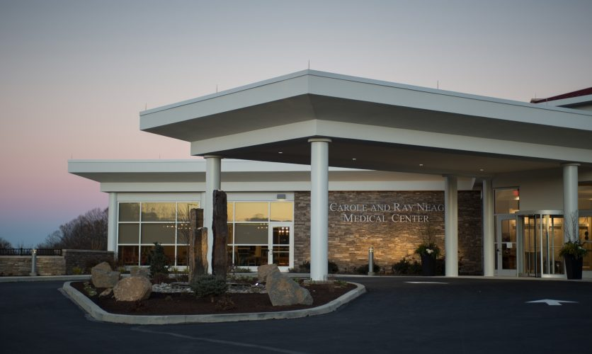 Exterior of the Neag Medical Center at Caron's campus in Wernersville, PA, at sunset.