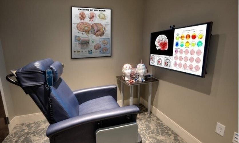 Neurofeedback room with a chair and tv at the Caron Pennsylvania campus.