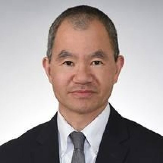 A headshot of Dr. Ming R. Wang.
