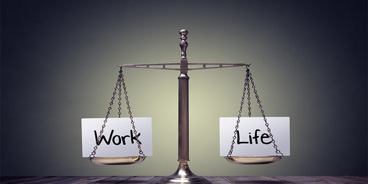 """A balance scale with the words """"work"""" and """"life"""" on each side."""