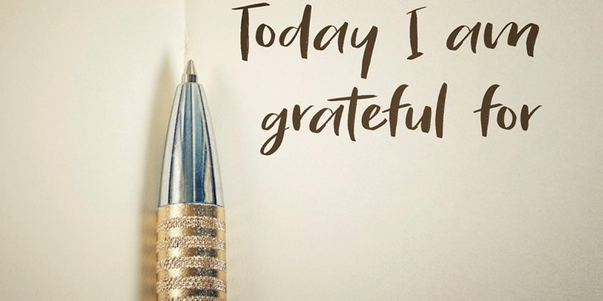 """Ball point pen against paper with the words """"Today I am grateful for"""" written down."""