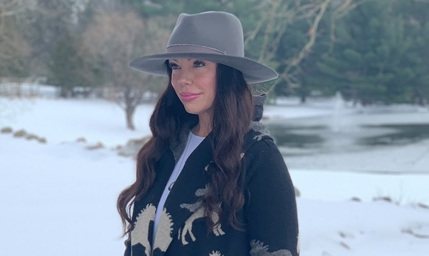 Woman in hat in the snow