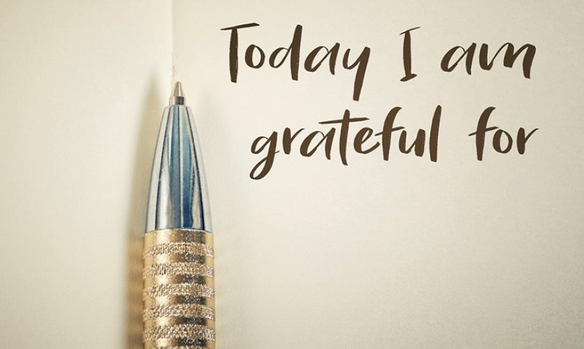 "Ball point pen against paper with the words ""Today I am grateful for"" written down."