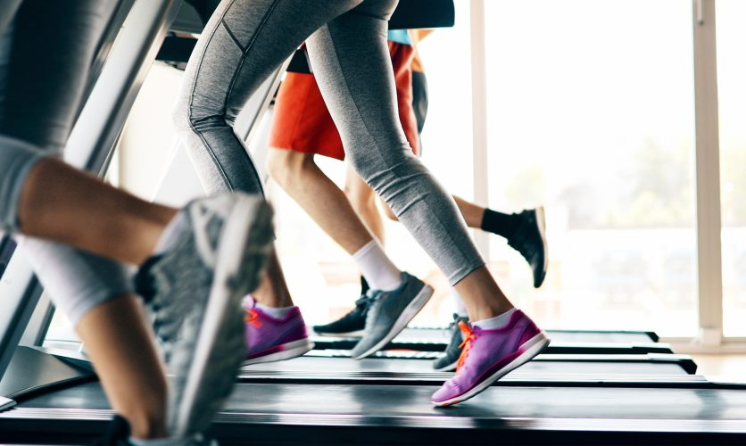 Mental and physical training with a closeup on people running on treadmills indoors.