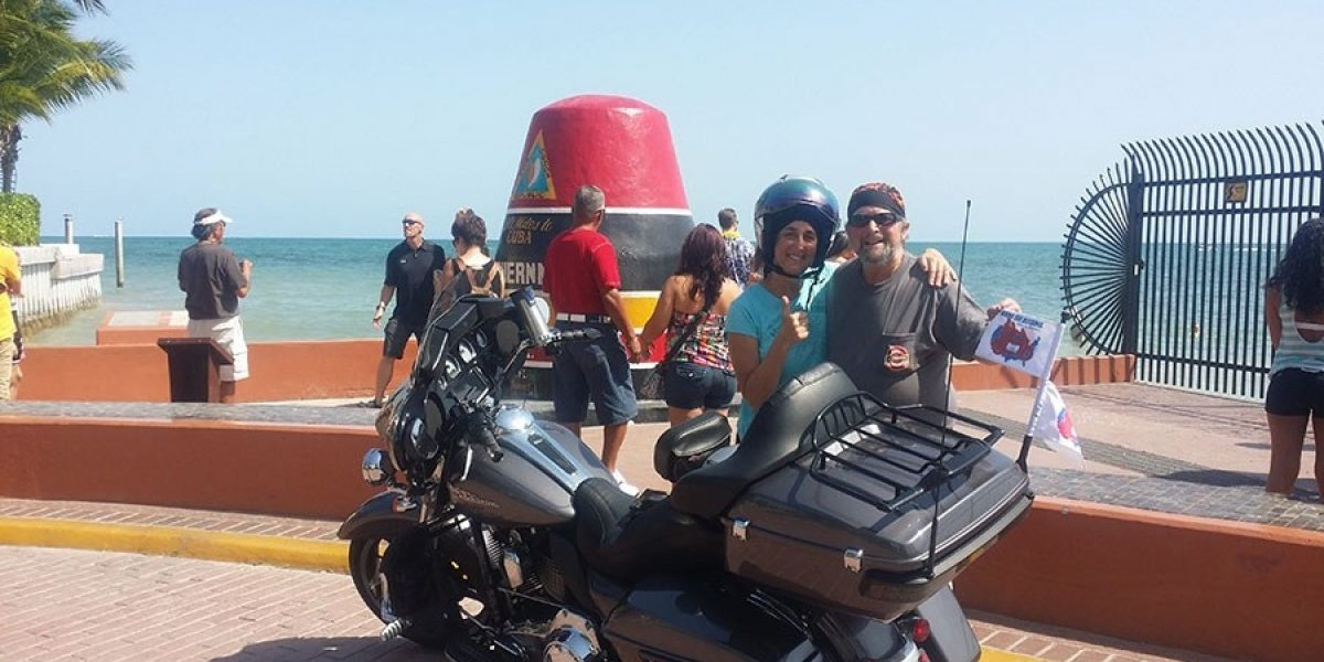 Photo of Bruce, Ellen and their motorcycle