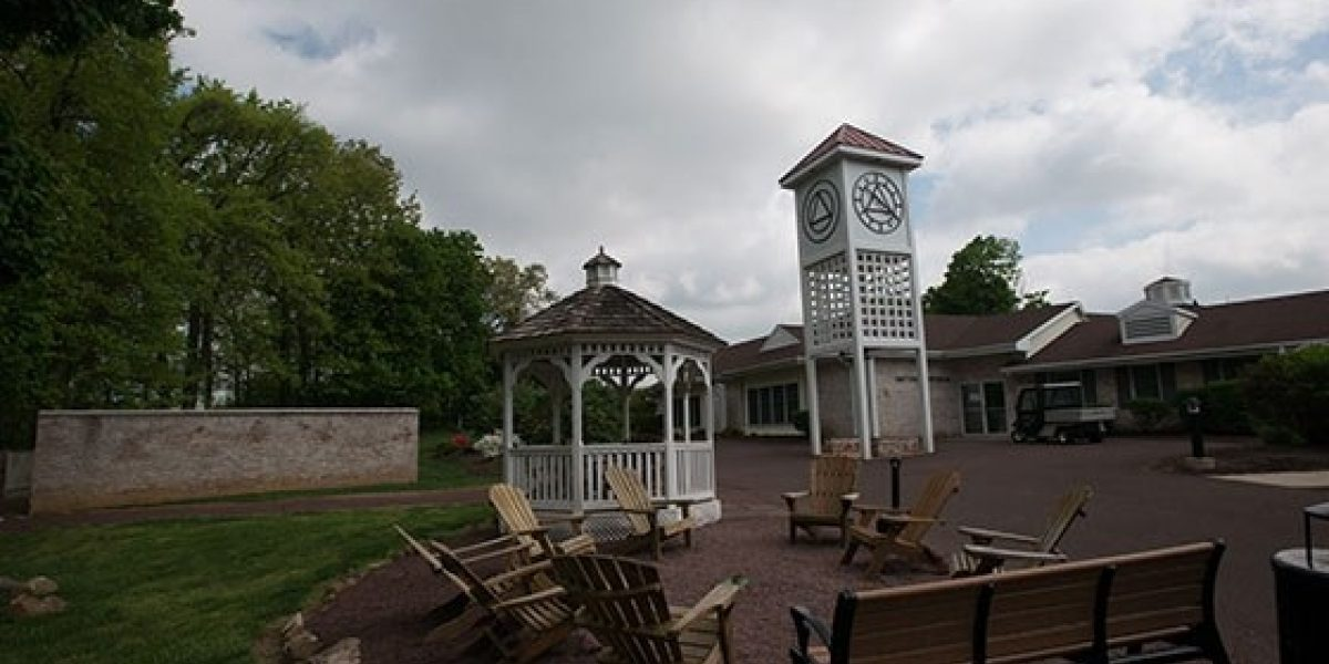 Photo of clock tower and gazebo outside adult dormitories