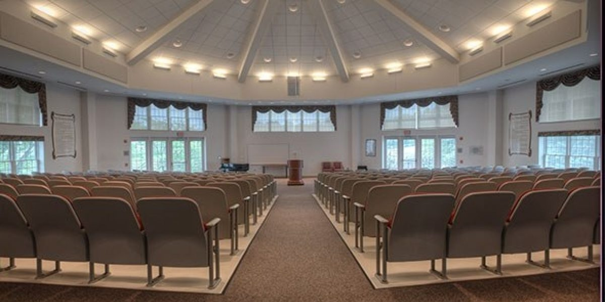 Photo of the auditorium from the perspective of the back of the room.