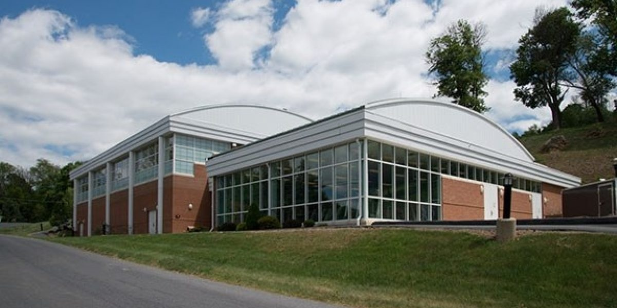 Photo showing the outside of Levin gym on a nice day