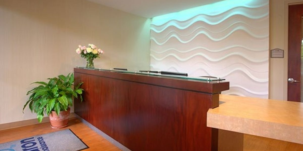 Photo of front desk at Beacon Square lobby.