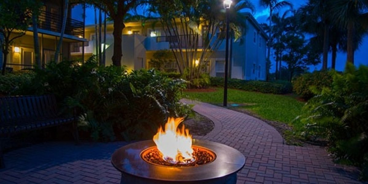 Photo of an outdoor fire pit ablaze at night on Renaissance's campus.