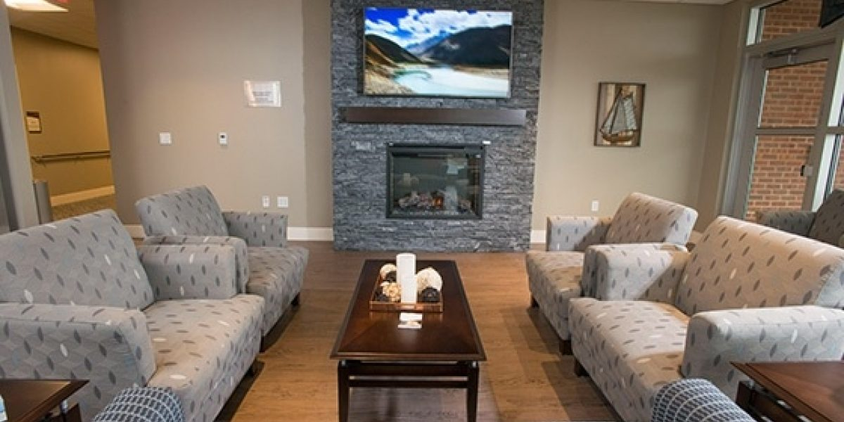 Photo of the older adult lounge featuring a tv and fireplace