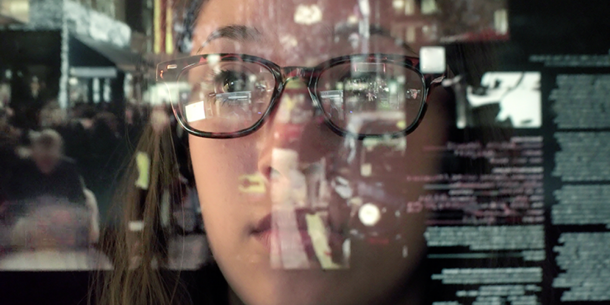 Close up of woman's face, looking thoughtful, with an image of text overlaid.