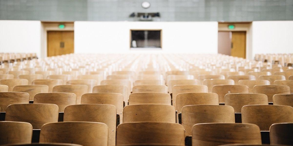 Empty seats in a college auditorium.