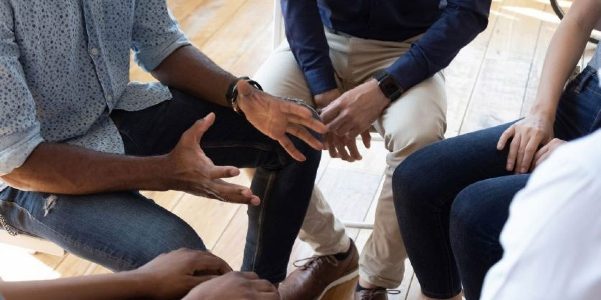 Group sitting in therapy circle