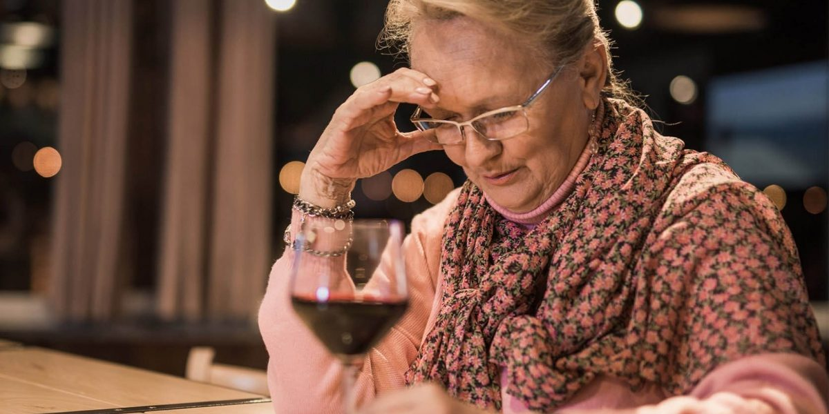 elder woman with glass of wine