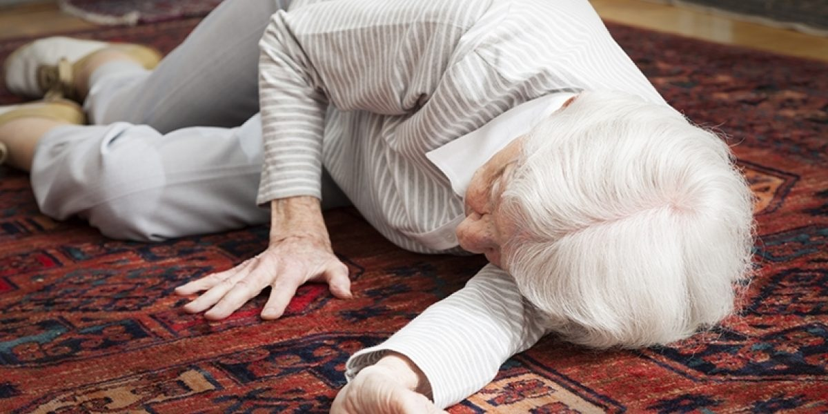 An older person who has fallen to the floor.