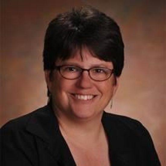 A headshot of Dr. Erin Deneke.