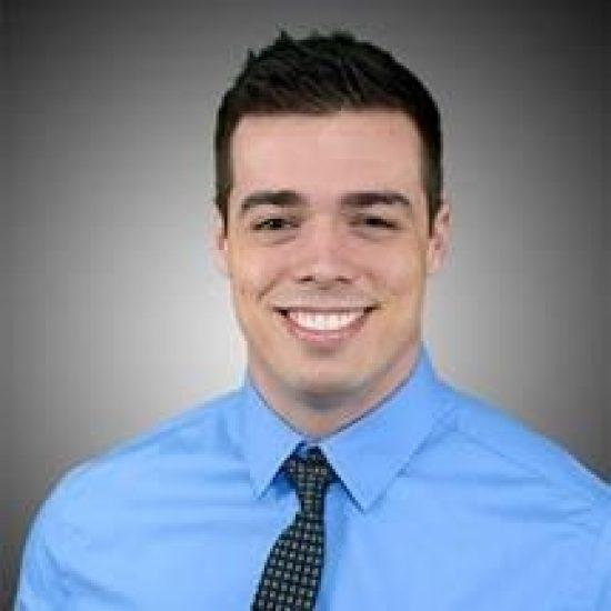 A headshot of Evan Emery.