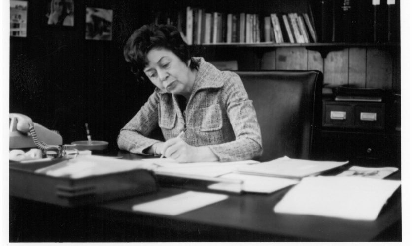 Catherine Caron at desk