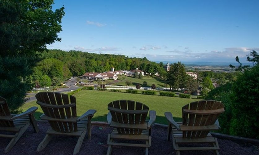 Photo of chairs overlooking rolling hills and blue skies