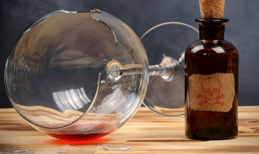 Broken wine glass and poison bottle