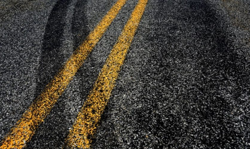 Skid marks crossing the center line of a road
