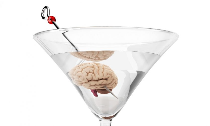 Close up of a martini with a brain replacing the olive.