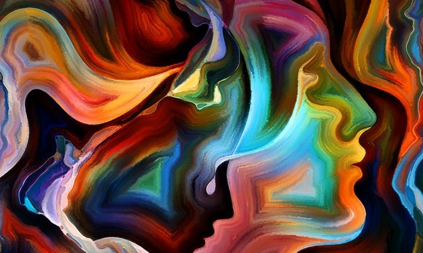 Bright, swirling colors form the profile of a face on a dark background.