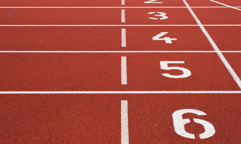 Close up of numbered lanes on an outdoor track.