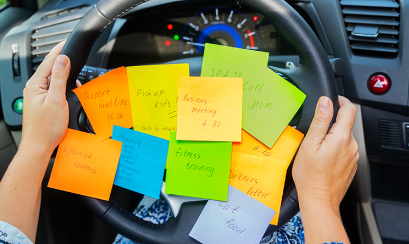 Steering wheel covered with sticky note reminders.
